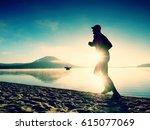 silhouette of sport active man... | Shutterstock . vector #615077069