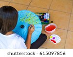 asia girl paint yellow flower...   Shutterstock . vector #615097856