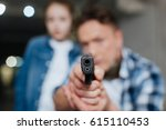 gun barrel being pointed at you | Shutterstock . vector #615110453