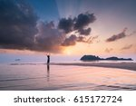 carefree woman in the sunset on ... | Shutterstock . vector #615172724