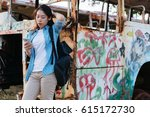 young asian woman using... | Shutterstock . vector #615172730
