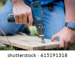 Workers Are Drilling Wood With...