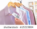 woman's hand with a cloth label ... | Shutterstock . vector #615215804