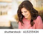 beautiful mature woman smiling. | Shutterstock . vector #615255434