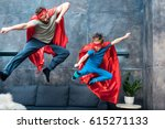 father and son in superhero... | Shutterstock . vector #615271133