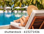 Woman Relaxing In Lounger At...