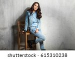 dark haired woman in jeans... | Shutterstock . vector #615310238
