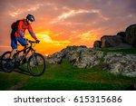 cyclist riding the mountain... | Shutterstock . vector #615315686