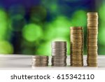 growing coins stacks with green ...   Shutterstock . vector #615342110