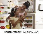 mother giving apple to daughter ... | Shutterstock . vector #615347264