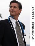 a doctor or surgeon or veterinarian, stands proud of his accomplishments and his accomplishments in society concepts - stock photo