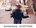 cheerful woman in the street... | Shutterstock . vector #615372260