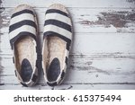 summer shoes on white wooden... | Shutterstock . vector #615375494