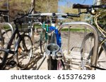 Small photo of Closeup of rusty lld bicycles in a parking without saddle
