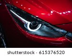 headlight of a modern luxury... | Shutterstock . vector #615376520