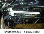 headlight of a modern luxury... | Shutterstock . vector #615376580