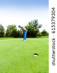 Golfer Ready To Take The Shot...