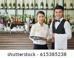 smiling waiter and waitress... | Shutterstock . vector #615385238