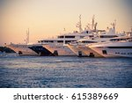 Luxury Yachts Moored In A...