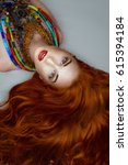 portrait redhead girl with a... | Shutterstock . vector #615394184