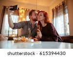 shot of a young couple taking a ... | Shutterstock . vector #615394430