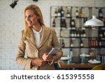 shot of modern business woman... | Shutterstock . vector #615395558