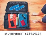 preparing for the trip. young... | Shutterstock . vector #615414134
