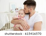 father with cute baby daughter... | Shutterstock . vector #615416570