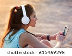 young smiling woman with sporty ... | Shutterstock . vector #615469298