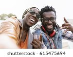 two black race friends having... | Shutterstock . vector #615475694
