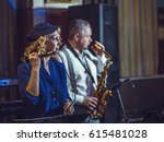 Small photo of A singer and saxophonist in a restaurant. Artists of European appearance appear on stage.