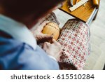 the hands of the craftsmen... | Shutterstock . vector #615510284