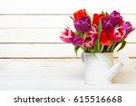 tulip bouquet on  wooden... | Shutterstock . vector #615516668