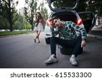 young couple on the road has... | Shutterstock . vector #615533300