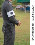 Small photo of Security police standing with white armlet and gun.