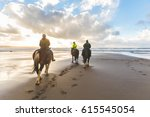 people horse riding on the... | Shutterstock . vector #615545054