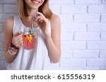 young woman with lemonade near...   Shutterstock . vector #615556319