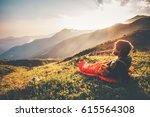 man relaxing in sleeping bag... | Shutterstock . vector #615564308
