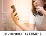 Small photo of Asian woman hand holding credit card and looking at smart phone with laptop, Technology Online shopping and Security Authorization Access code background concept