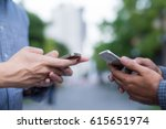 close up of two people hands... | Shutterstock . vector #615651974