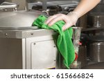 hand in protective glove with... | Shutterstock . vector #615666824