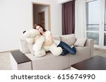 young woman on the couch in the ... | Shutterstock . vector #615674990