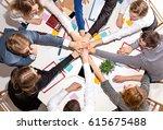 team sitting behind desk ... | Shutterstock . vector #615675488