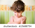 Small photo of Portrait of little kid with angry upset face expression. Cute child making a sad face