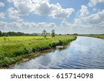 canalised river and cloudy sky... | Shutterstock . vector #615714098