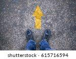 man standing with yellow arrow...   Shutterstock . vector #615716594