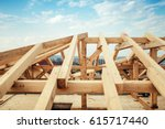 Installation of wooden beams and timber at construction site. Building the roof truss system structure of new residential house - stock photo