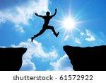 man jump through the gap.... | Shutterstock . vector #61572922