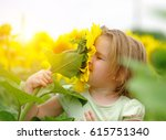 happy little girl smelling a... | Shutterstock . vector #615751340