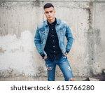 stylish guy standing  street in ... | Shutterstock . vector #615766280